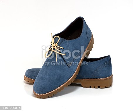 Suede leather blue shoes isolated on a white background.