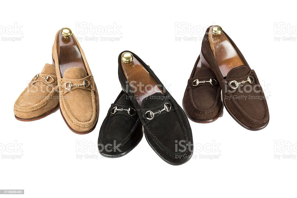 Suede loafers on white background stock photo