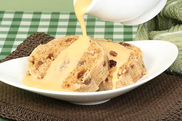suet pudding and custard stock photo