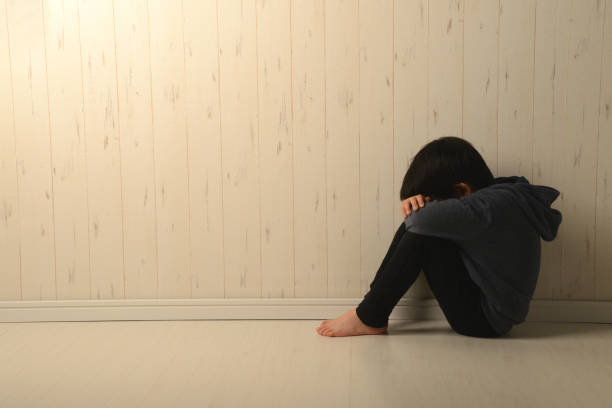 Suffering child in dark room Suffering child in dark room absentee stock pictures, royalty-free photos & images