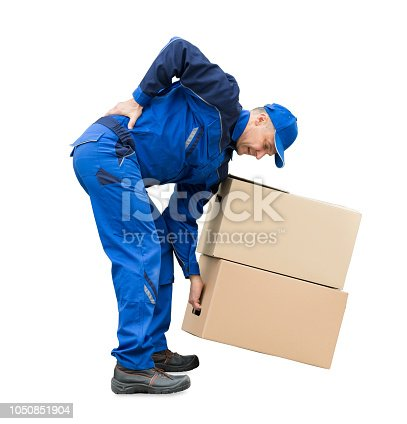istock Suffering From Back Pain While Lifting Cardboard Boxes 1050851904