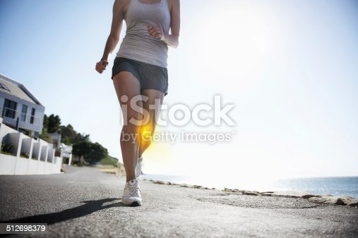 512698489 istock photo Suffering from knee pain 512698379