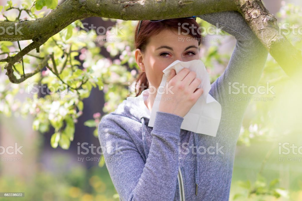 Young woman suffering from Pollen allergy, alergy season, Girl...