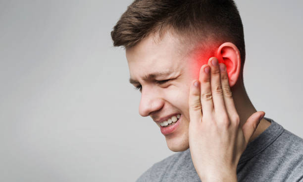 Suffering man touching his inflamed head, empty space stock photo