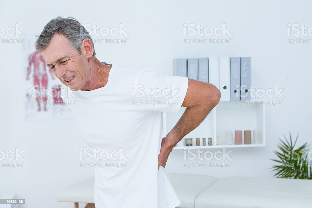 Suffering patient touching his back stock photo