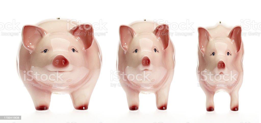 Suffering piggy bank metamorphosis stock photo