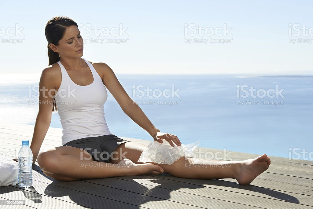 Suffering through a sports injury stock photo