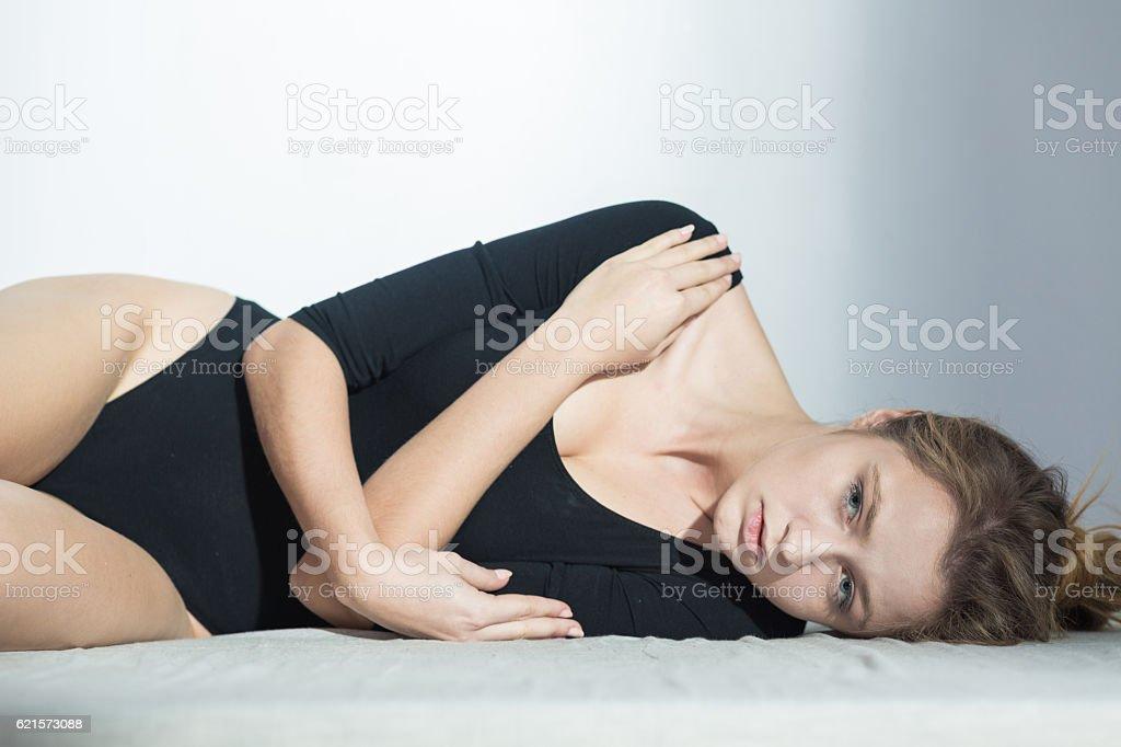 Suffering woman wearing black body photo libre de droits