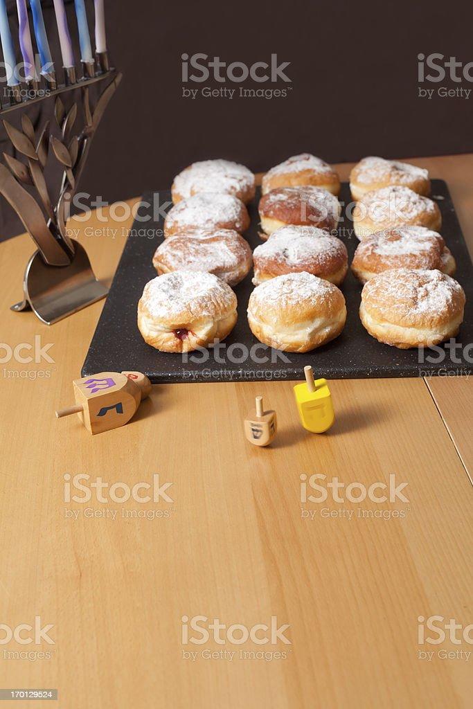 Sufganiyot- Hanukkah Doughnuts, and dreidels stock photo