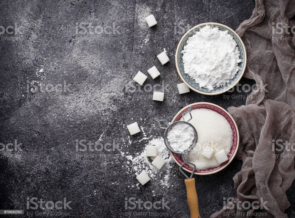 Sugar and powder on concrete background stock photo