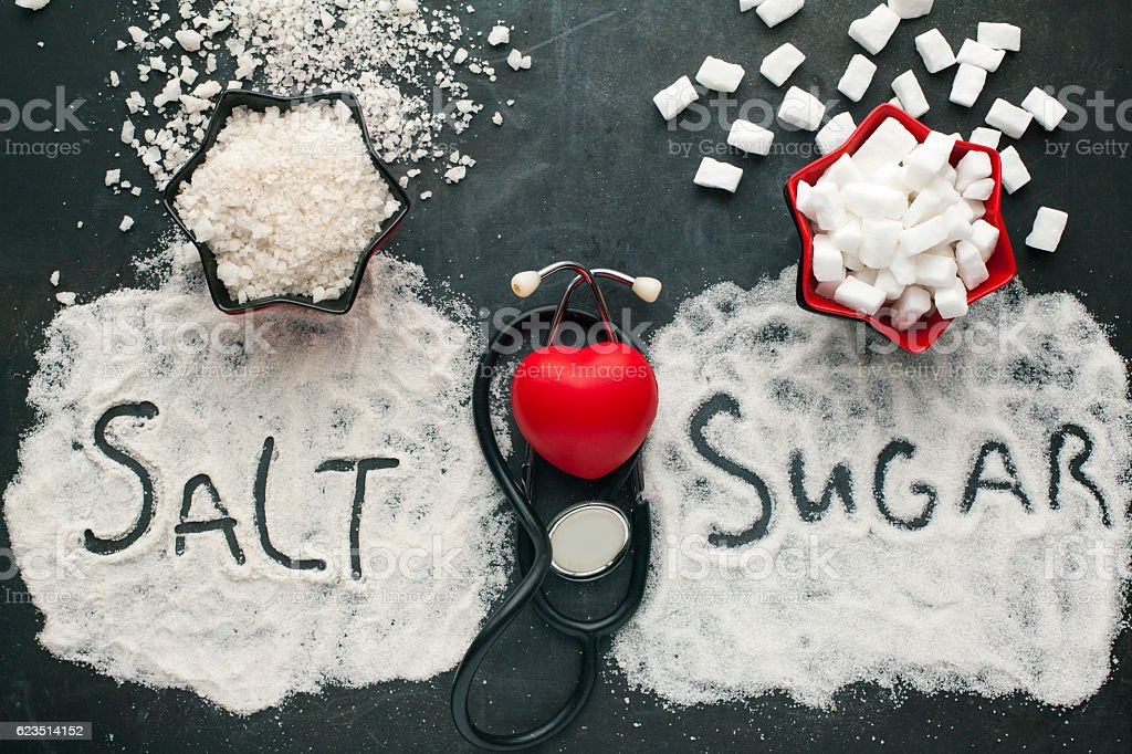 Sugar and salt brings harm to the heart. stock photo