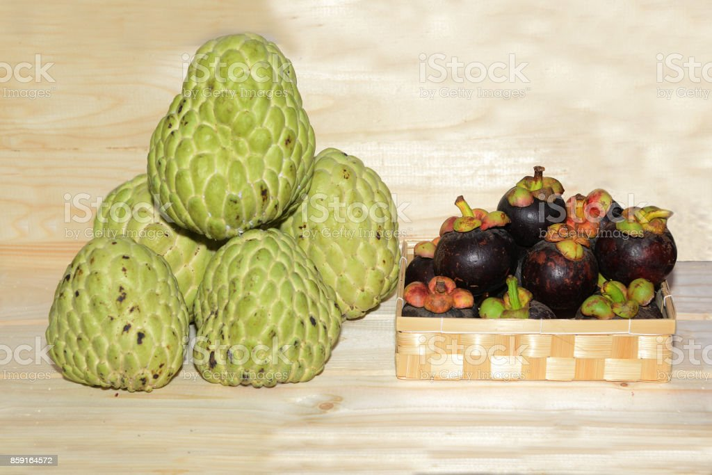 Sugar apple and Mangosteen fruits on a shelves. stock photo