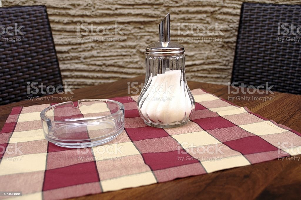 Sugar Bowl and Ash Tray on the Cafe Table royalty-free stock photo