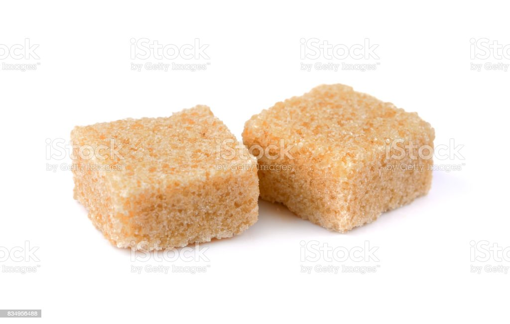 sugar brown square on white stock photo