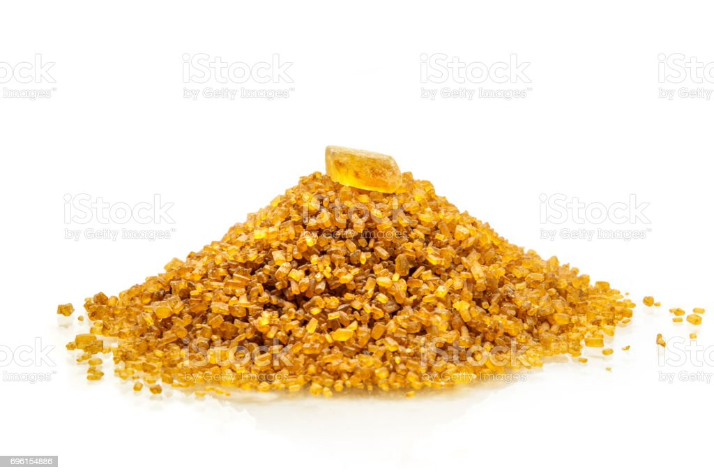 Sugar candy on top of mound of brown sugar stock photo