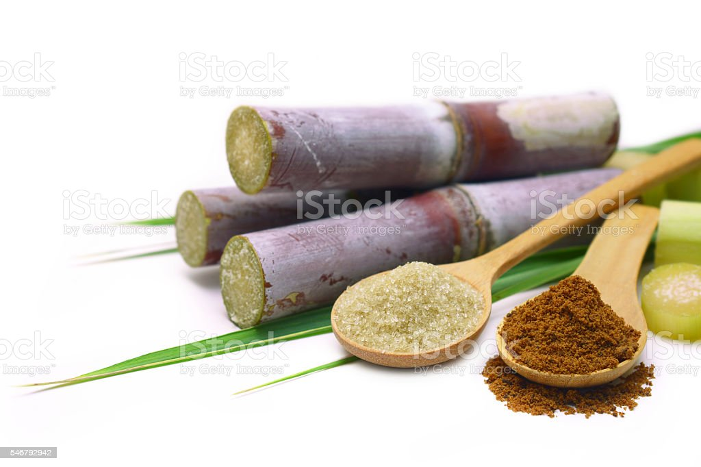 Sugar cane with brown sugar. stock photo
