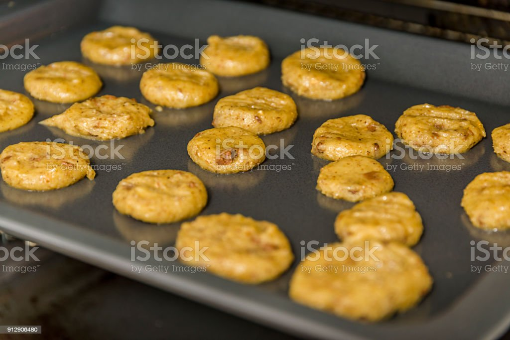 Sugar cookies baking in oven. Closeup with shallow dof. stock photo