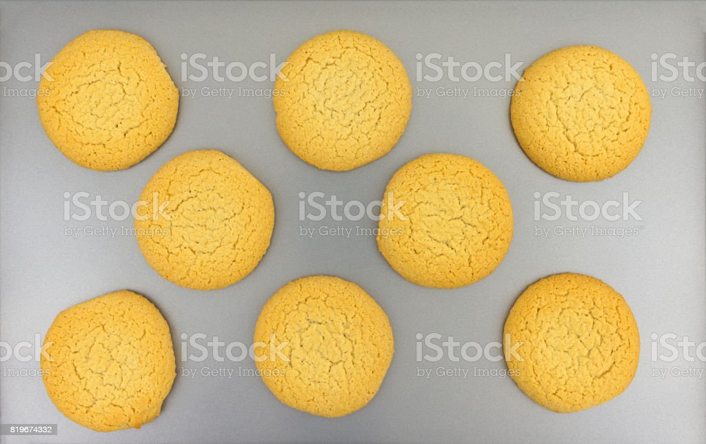 Sugar cookies on a baking sheet top view stock photo