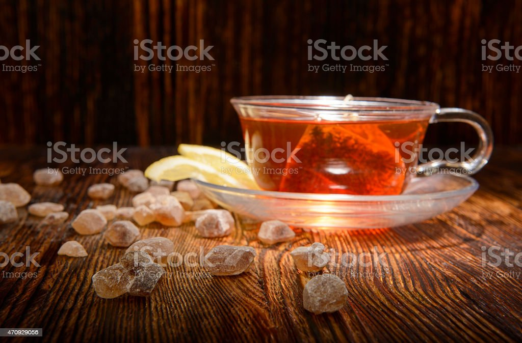 sugar crystals and tea on a wooden background stock photo
