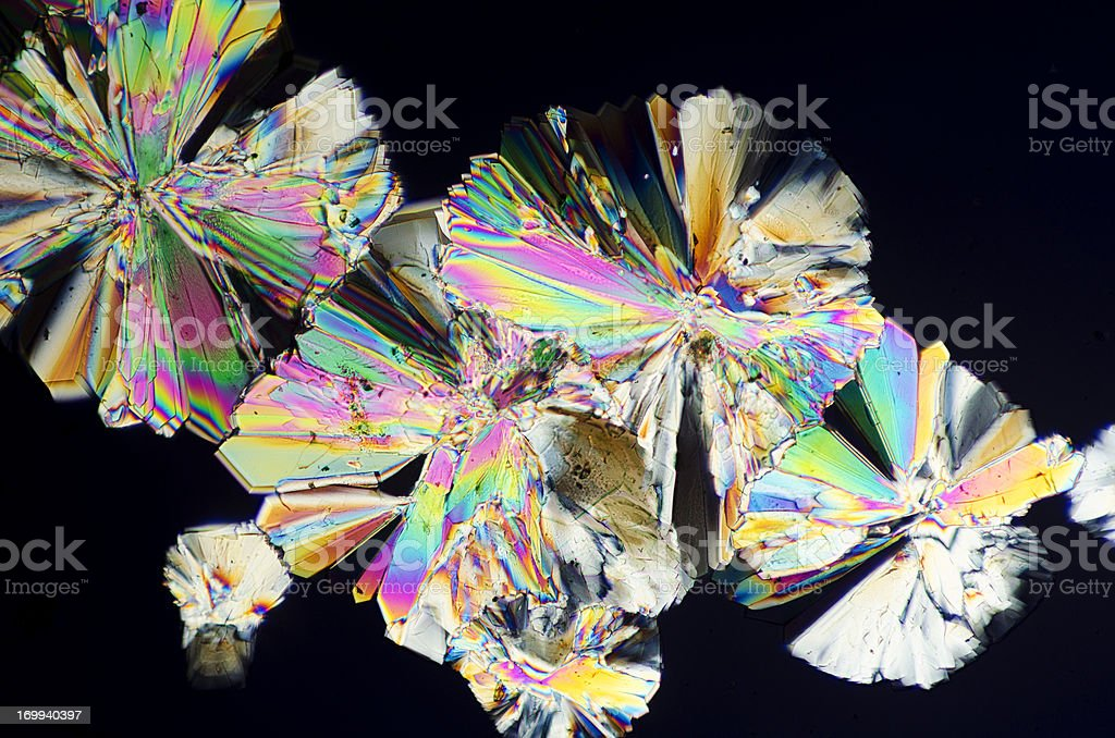 sugar crystals micrograph in abstract pattern Photomicrograph of dextrose sugar crystals. Dry mount, 5X objective, polarized illumination. Abstract Stock Photo
