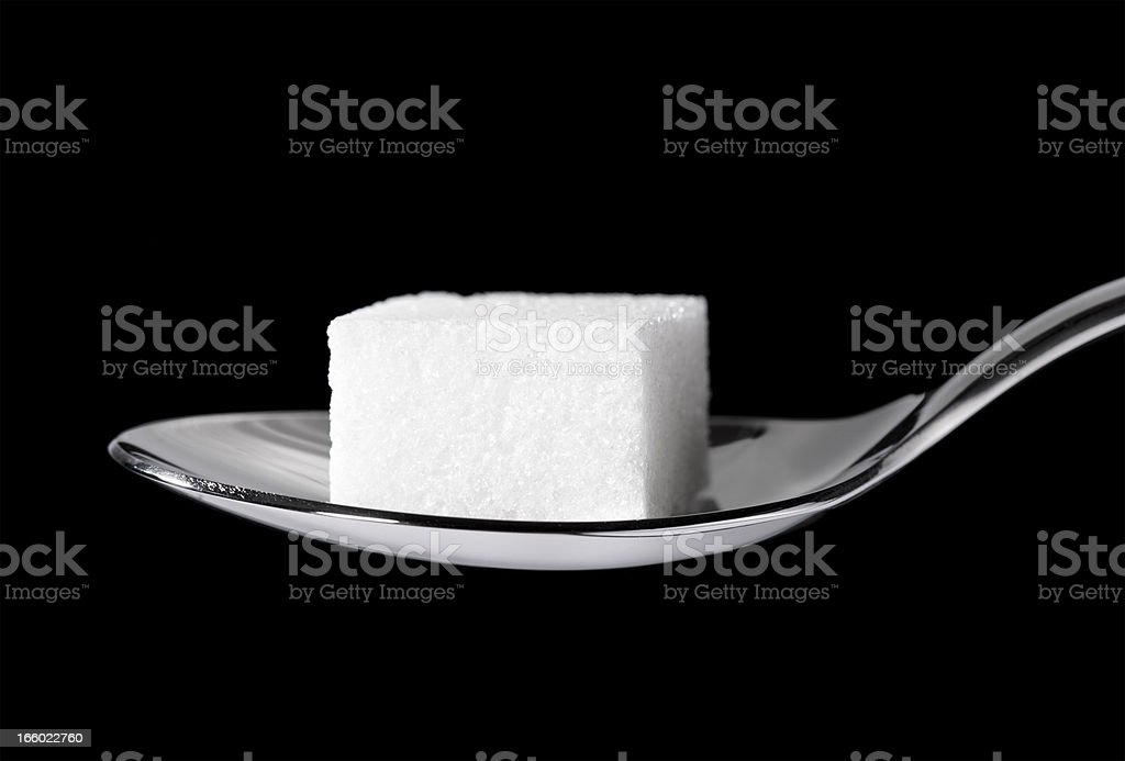 Sugar Cube on a Teaspoon stock photo