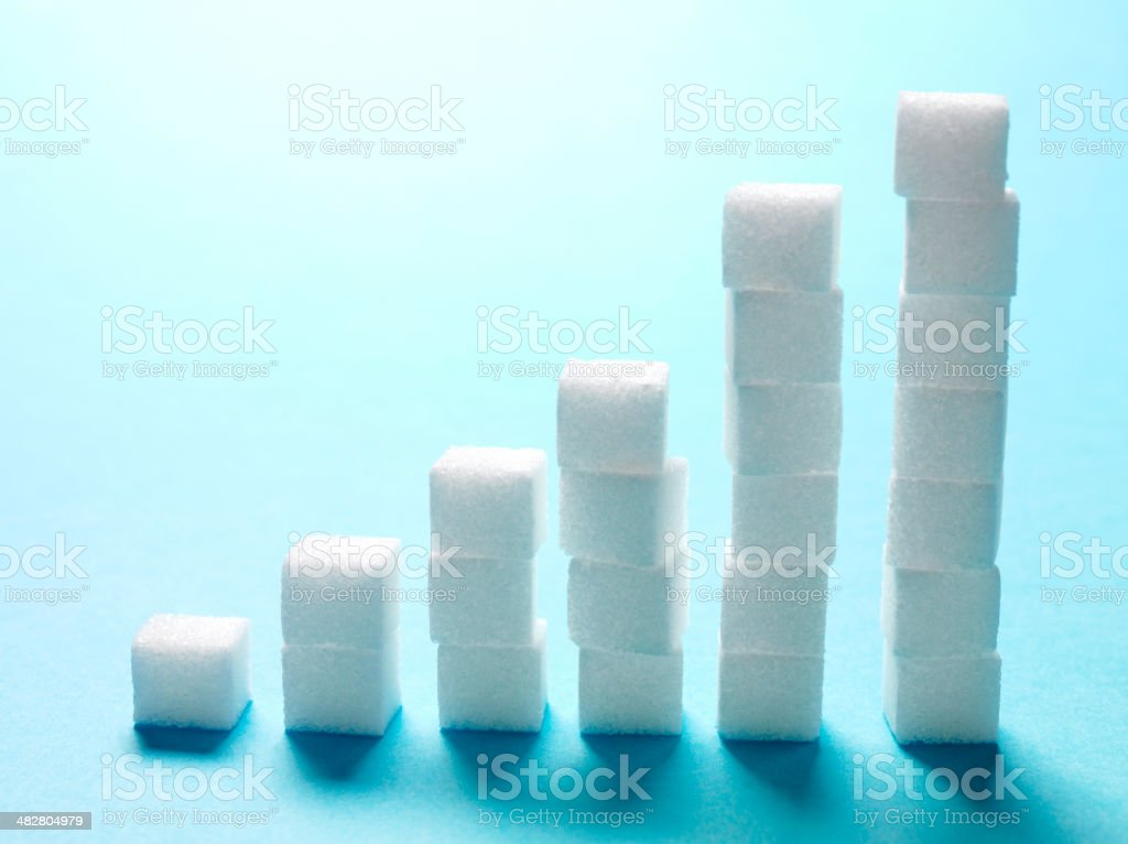 Sugar Cubes Bar Chart on a Blue Background stock photo