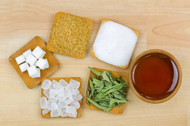 sugar cubes, brown sugar crystals, granulated white sugar, rock sugar, stevia, honey, different types of sweetness - sweeteners stock photos and pictures