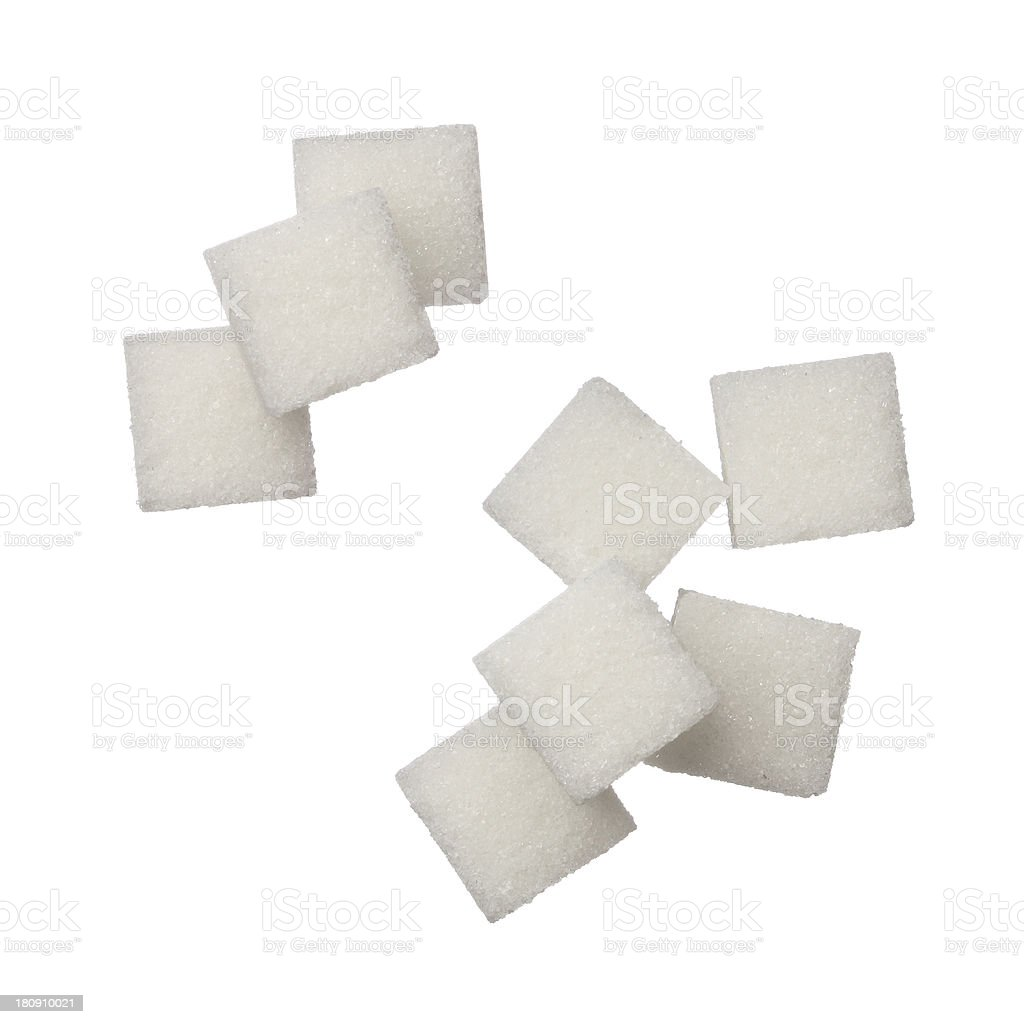 Sugar cubes free falling on white background stock photo