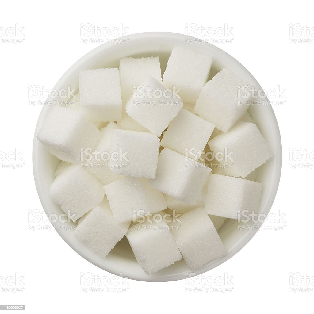 Sugar cubes in a bowl isolated on white background stock photo