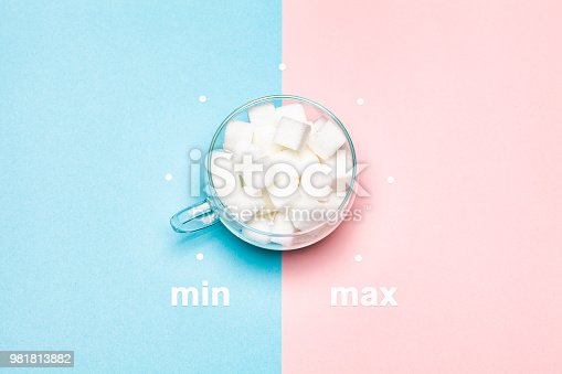 Conceptual photography: Sugar cubes in glass cup