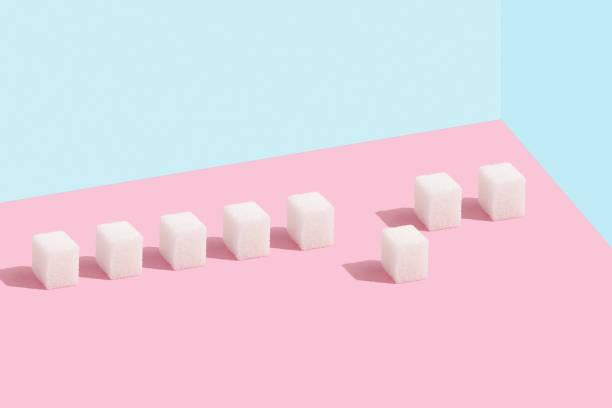 Zuckerwürfel in Reihe und Zuckerwürfel aus der Masse Minimal – Foto