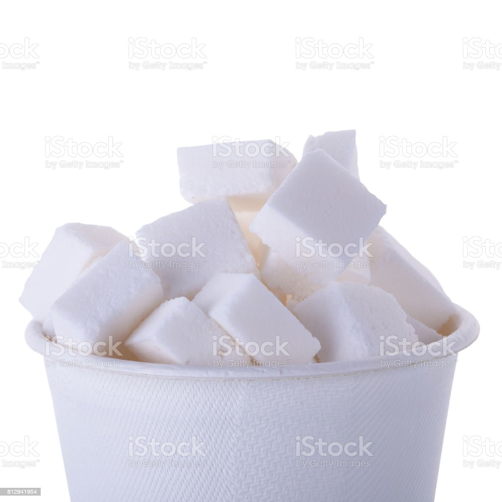 Sugar cubes in wooden spoon isolated on a white background stock photo
