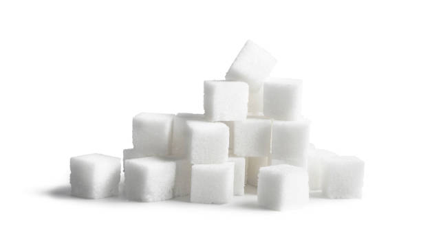 Sugar cubes isolated on white background stock photo