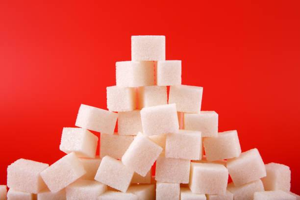 Zuckerwürfel auf rotem Grund – Foto
