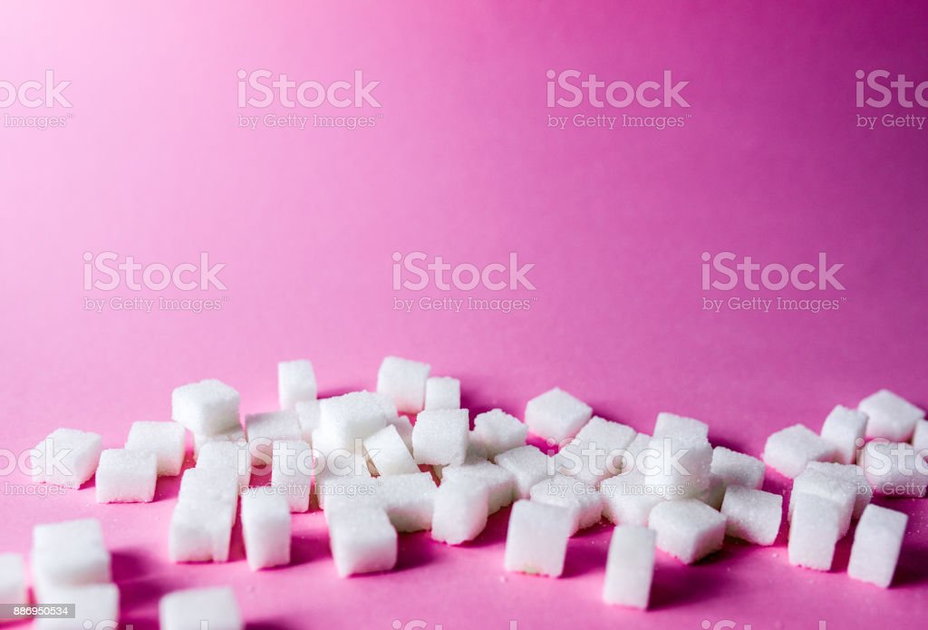 sugar cubes on spoon stock photo