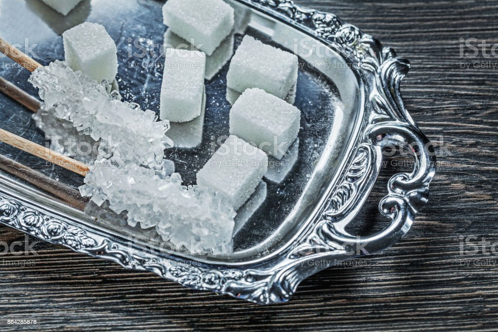 Sugar cubes sticks tray on wooden board royalty-free stock photo