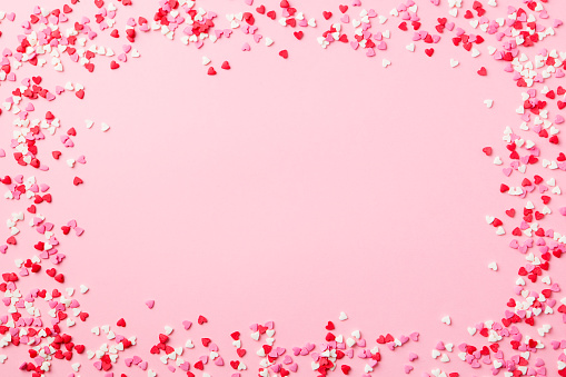 Sugar hearts frame on pink background. Romantic, St Valentines day concept. Top view. Copy space