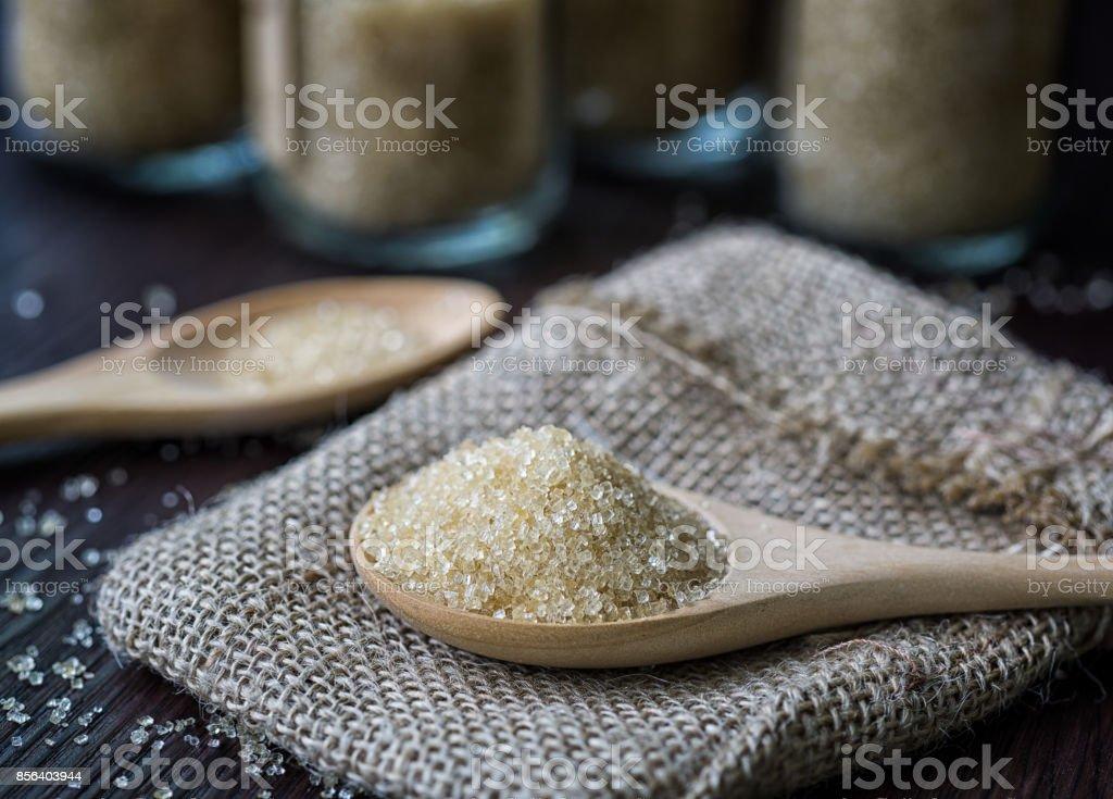 Sugar in wood spoon stock photo