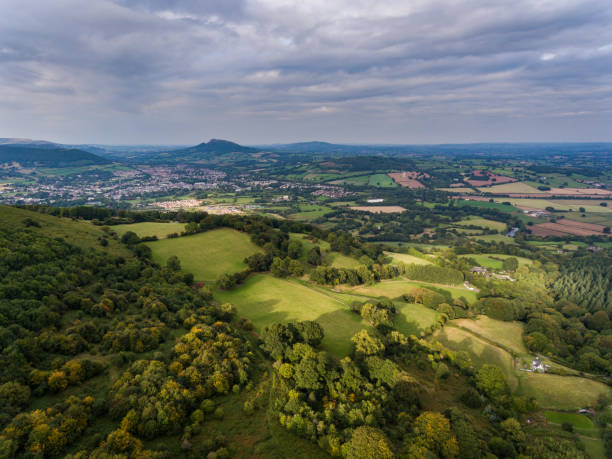 Sugar Loaf mountain and farm land in Monmouthshire An aerial view of the Sugar Loaf mountain and farm land in Monmouthshire, Abergavenny, Wales south wales stock pictures, royalty-free photos & images