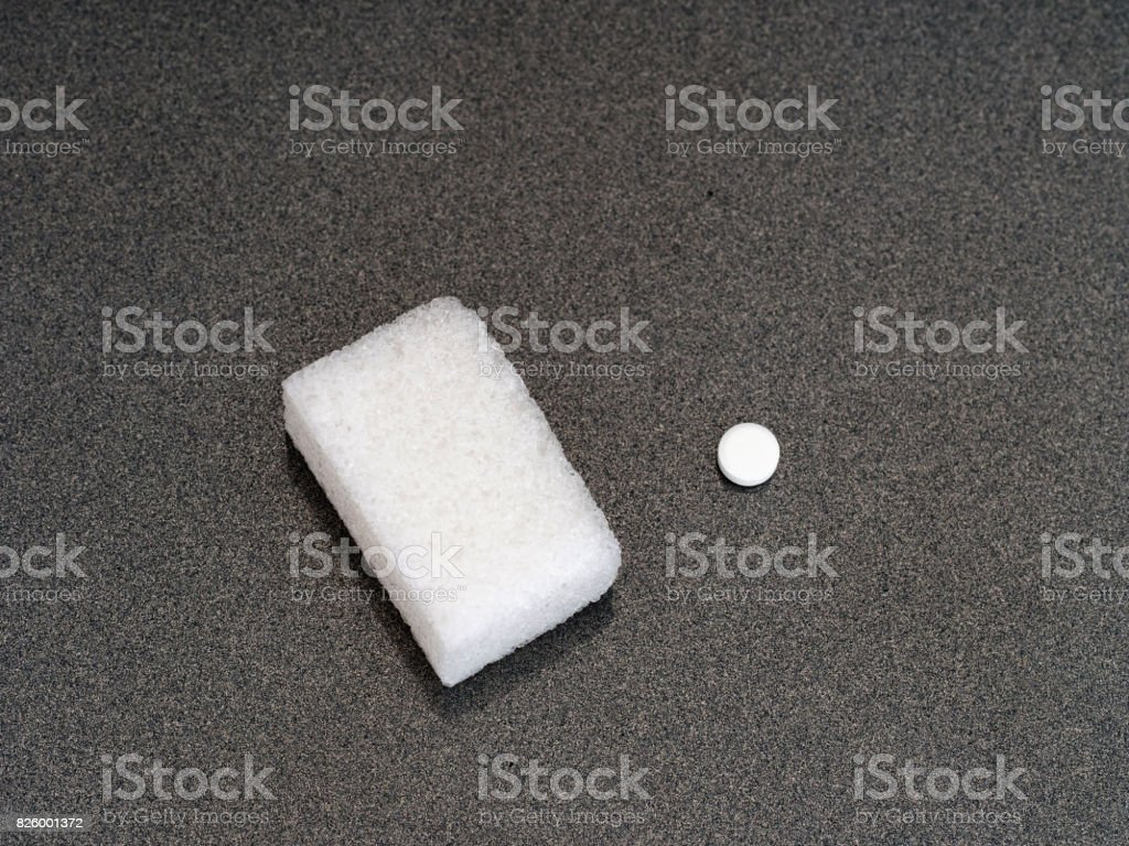 Sugar or artificial sweetener. The choice. One of each on grey. stock photo