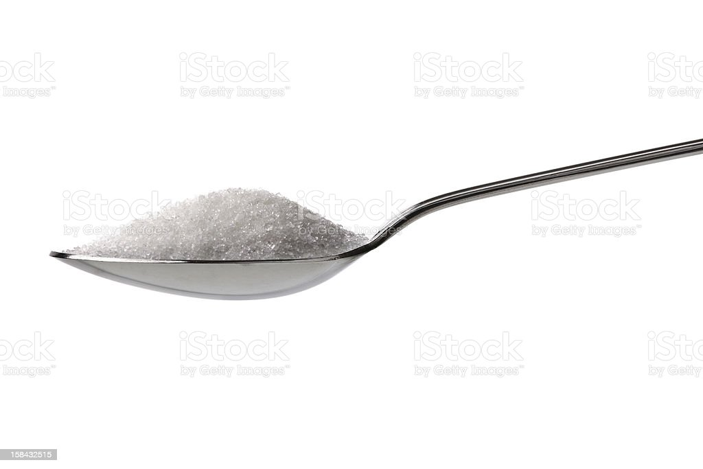 Sugar or salt on a teaspoon stock photo
