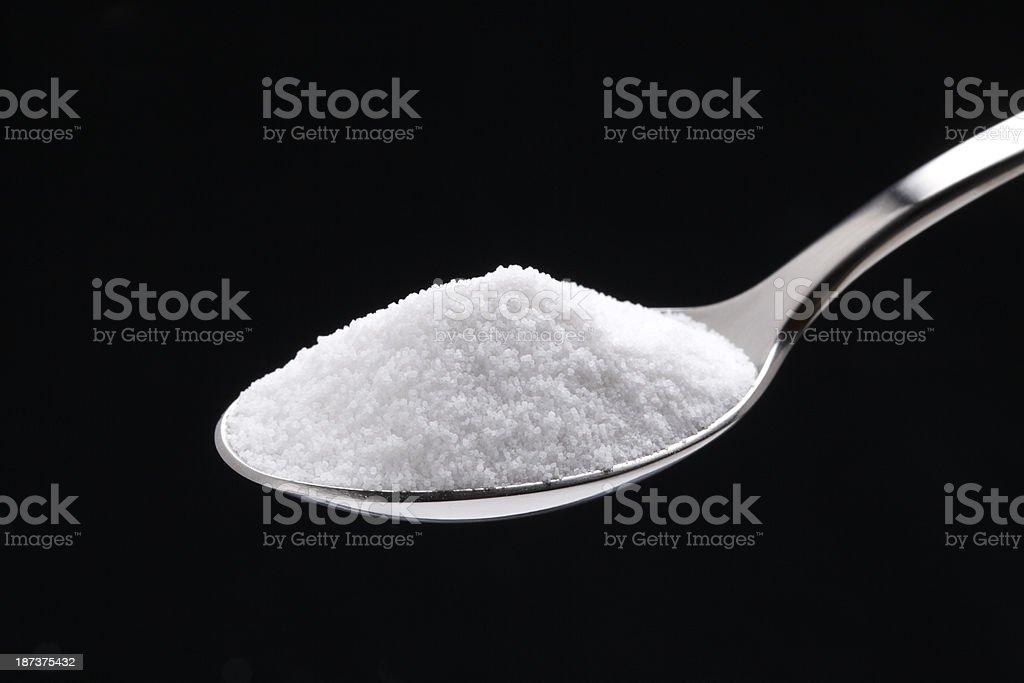 Sugar or Salt on spoon stock photo