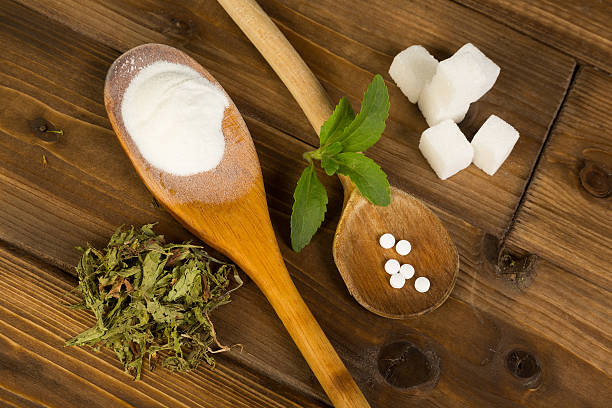 sugar or stevia - sweeteners stock photos and pictures