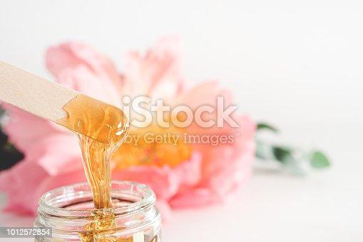 image of liquid sugar for skin depilation