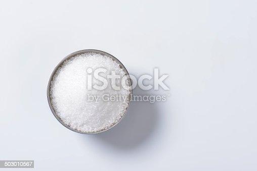 bowl of white sugar isolated on white background