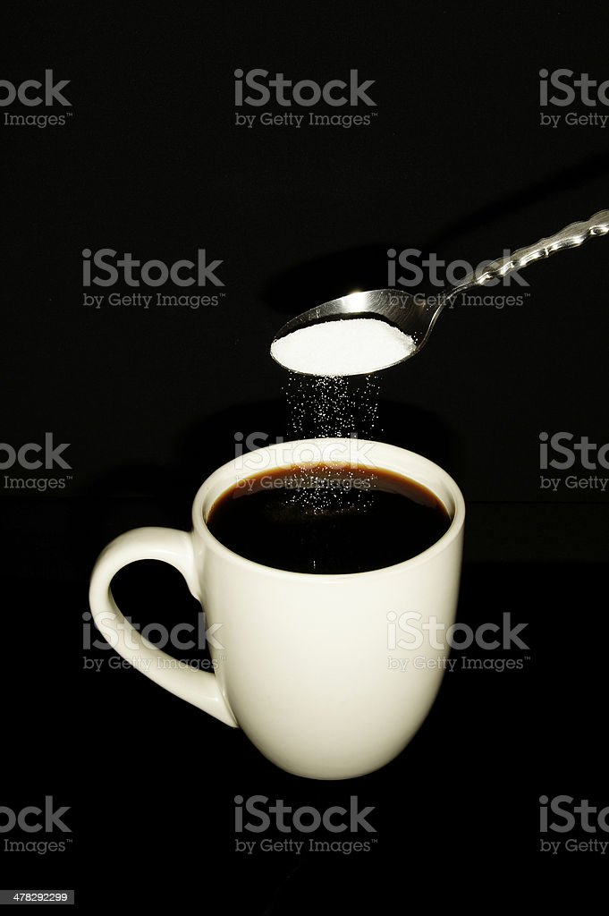 Sugar Poured Into Mug with Coffee Portrait royalty-free stock photo