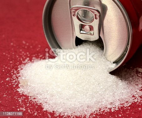 istock sugar pouring out from alluminium can, health concept 1128271155