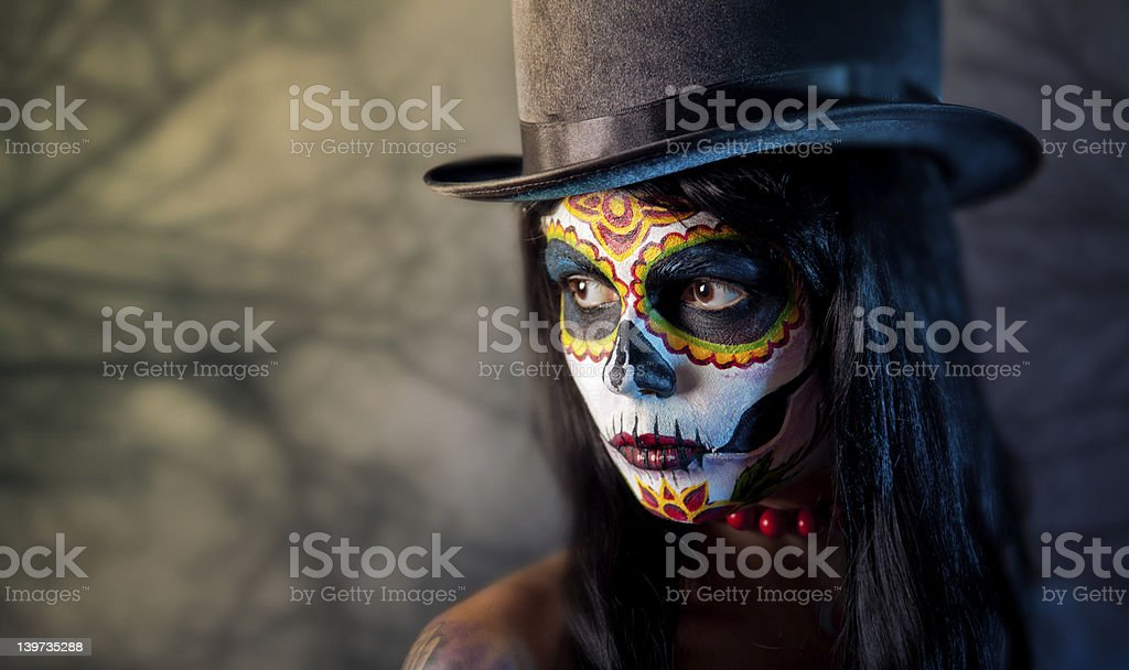 Sugar skull girl in tophat stock photo