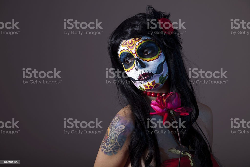 Sugar skull girl with red rose stock photo