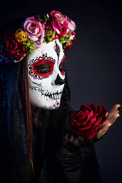 sugar skull makeup girl with rose - plants of zombies stock-fotos und bilder